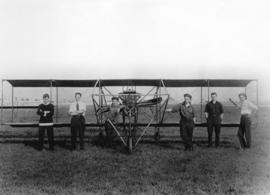 [Members of the first Aero Club in British Columbia in front of their bi-plane at Minoru race track]
