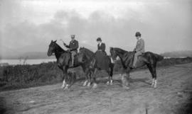 [Johan Wulfsohn (German Consul), and unidentified man and woman, on horseback]
