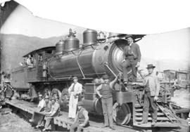 [Men posing with] No. 314 heavy grade engine at Field, B.C., C.P.R.