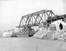 Second Narrows Bridge, 6th March 1925. Shewing [showing] steel span on scows entering its place b...