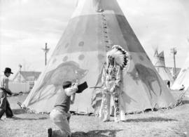 [Stoney Indian posing for photographer, Lionel Green, at the Calgary Stampede]