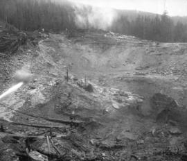 Coquitlam Dam [showing] sluicing material by hydraulic monitor
