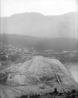 [Partially constructed Coquitlam Dam, showing dam area and construction camp]