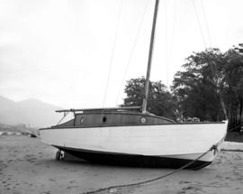 "[Yacht ""Jeanine"" on Kitsilano Beach after a storm]"