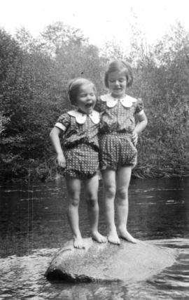 Alix Louise Gordon and Jane Banfield standing on rock in stream
