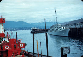 Ship at dock with Vancouver fireboat at anchor in foreground