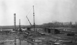 Construction site with cranes and outbuildings