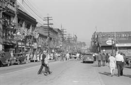 [A parade celebrating VJ Day on Pender Street]
