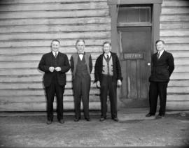 [Men Standing outside the B.A. Oil Company office]