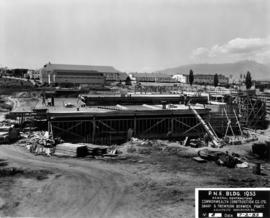 Construction of P.N.E. B.C. building with Forum, Pure Foods, and Pavilion of Modern Living in bac...