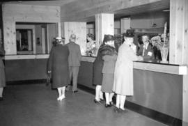 [People at the coat check of the Burrard Servicemen's Centre, 636 Burrard Street]