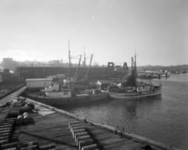 [Boats lined up at the B.A. Oil Company Wharf]