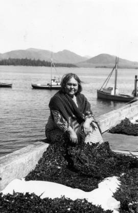 [Native woman drying seaweed]