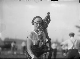 Woman playing bagpipes