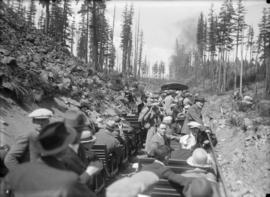 Pacific Great Eastern Railway - first trip to Alta Lake [passengers on an open rail car going thr...