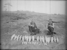 """J.C."" [James Crookall] and ""T.M."" with salmon catch"