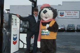 Sam Tremblay and Tillicum at Tremblay and Sons Chevron Station on 4th Avenue and Macdonald Street