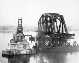 Second Narrows Bridge, 9th April 1925. 300 foot steel span approaching its place between Piers 1 ...