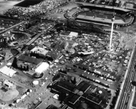Aerial photograph of P.N.E. grounds, including B.C. building, Playland, Space Tower, and Empire S...