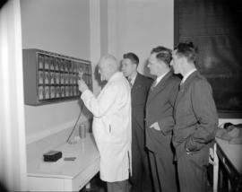 [Men looking at chest x-rays as part of a tuberculosis screening program]