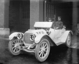 [Assistant Fire Chief Thompson and Fire Department vehicle]