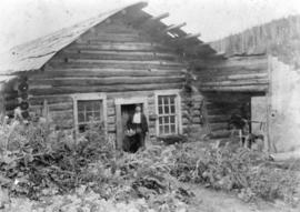 [Jack Pinkerton at his cabin on Lowhee Creek]