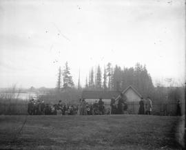 [Women's field hockey team gathered in field at Brockton Point grounds]