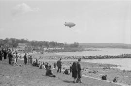 [U.S. Navy blimp off English Bay beach]