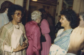 Two unidentified women talking in Grand Ballroom