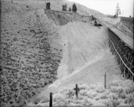 Filling the trestle at Mile 2.2 K.V.R. : The material castover at end of second cut [west side of...