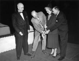 G.S. Powell, J.S.C. Moffitt, and unidentified man and woman at driving range