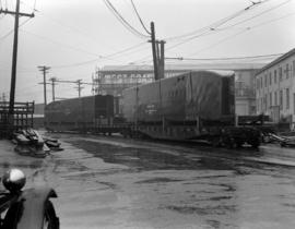 [Large metal structures on a railway freight car at Western Bridge and Steel Fabricators]