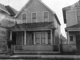 [View of one-storey house at 718 Pender Street]