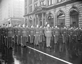 [Soldiers at attention outside the Winch Building]