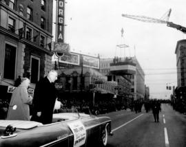 [Mayor Hume and John Dunsmuir in car on Georgia Street near Granville Street in the Grey Cup Parade]