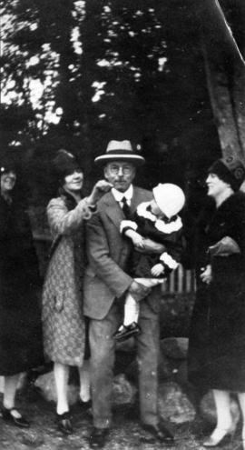 [Group portrait showing L.D. Taylor holding young girl]
