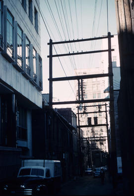 [Utility poles and transmission lines in a Downtown alley]