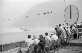 [Spectators on dock watching speed boat racing on Harrison Lake]