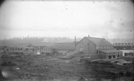 [Vancouver Manufacturing and Trading Company building and work yard near the foot of Granville St...