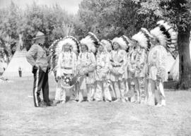 [RCMP Officer with Stoney Indian group at the Calgary Stampede]