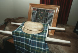 Plate of haggis placed on a piece of the Centennial tartan fabric