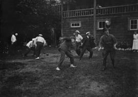 Group playing a game on the lawn