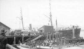 [Passengers waiting at the Union Steamship Company wharf]