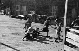 [Children playing on dock]