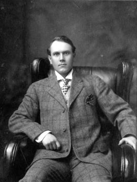 [Portrait; Alfred T. Layne, seated in leather armchair]