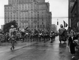 Marching band and balloon figures in 1950 P.N.E. Opening Day Parade