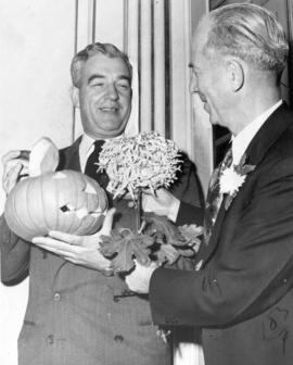 [Art Richardson and Mr. J.A. Johnston at a chrysanthemum show]