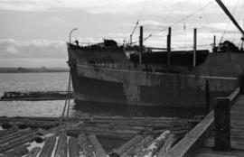 [Bow of freight ship at dock]