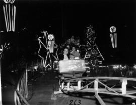 Children on rollercoaster in P.N.E. Gayway at night