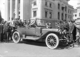 [Mayor Gale and other dignitaries assembled around car decorated for the campaign to build the Tr...